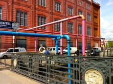 Pink and blue pipes taking swamp water out